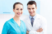Female nurse and male doctor — Stock Photo