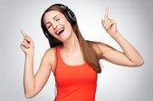 Woman wearing headphones — Stock Photo