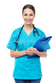 Female doctor holding a clipboard — Stock Photo