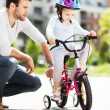 Girl learning to ride a bike — Stock Photo #47022555