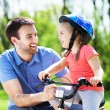 Girl learning to ride a bike — Stock Photo #47022881