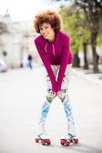 Woman roller-skating — Stock Photo