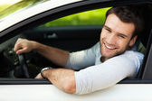 Man sitting in a car — Stock Photo