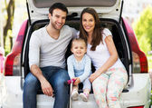 Family sitting in the car — Foto de Stock