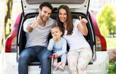 Family sitting in the car — Stock Photo