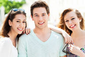 Man with two female friends — Stock Photo