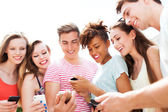 People looking at smartphones — Stock Photo