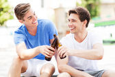 Young men having beer — Stock Photo