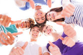 Friends showing thumbs up — Stock Photo