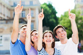 Friends pointing up — Stock Photo