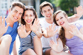 Friends waving hands — Stock Photo