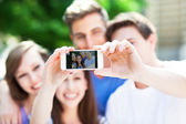 Friends taking photo of themselves — Stock Photo