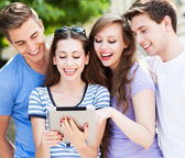 Students with tablet computer — Stock Photo