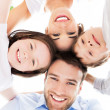 Family smiling together outdoors — Stock Photo #49076293