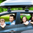 Happy family sitting in the car — Stock Photo #49076389