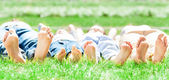Family feet on grass — Stock Photo