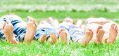 Family feet on grass — Stock Photo