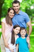Happy family of four — Stock Photo