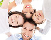 Family smiling together outdoors — Stock Photo
