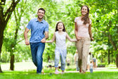Young Family Having Fun In Park — Stock Photo