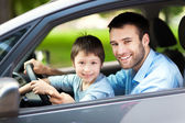 Father and son sitting in a car — Stock Photo