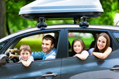 Happy family sitting in the car — Stok fotoğraf