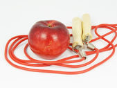 Skipping rope and apple — Stock Photo