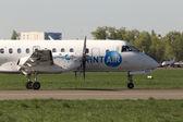 SprintAir Saab 340 aircraft running on the runway — Stock Photo