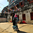 Muslim Young WomWalking in flags decorated streets of Stonecity, Zanzibar — Stock Photo #25702077