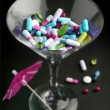 Cocktail of drugs in a glass — Stock Photo