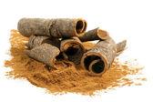 Cinnamon powder and sticks — Stock Photo