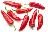 Group of red chilies on white background — Stock Photo