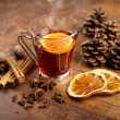 Mulled wine with orange and spices on wooden background — Stock Photo #25054555