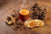 Mulled wine with orange and spices on wooden background — Stock Photo