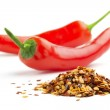 Pile of crushed chillies and fresh red chilies — Stock Photo #25067393