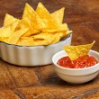 Mexican appetizer of tortilla chips and tomato sauce — Stock Photo