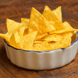 Bowl of tortilla chips on wooden background — Stock Photo