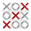 Stock Photo: Game of tic-tac-toe with diagonal of red crosses