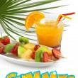 Tropical cocktail with fruit skewers snd summer word — Stock Photo #26888491