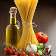 Pasta, tomatoes, olive oil, garlic, basil and spices — Stock Photo