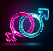 Male and female gender symbols on black background — Stock Photo