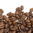 Edge of coffee beans on white background — Stock Photo