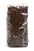 Clear plastic bag of coffee beans isolated on white background — Stock Photo