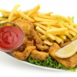 Chicken nuggets and fries with lettuce and ketchup on white background — Stock Photo
