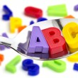 Letters A, B, C, in a tablespoon — Stock Photo