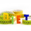 Diet word made of colorful letters and measuring tape — Stock Photo #29798249