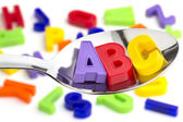 Letters A, B, C, in a tablespoon — Stockfoto