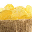 Extreme close up of potato crisps in a jute bag — Stock Photo