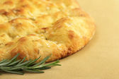 Close up of flatbread and sprig of rosemary — Stock Photo