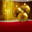 Three golden christmas baubles hanging on a glittering background — Photo